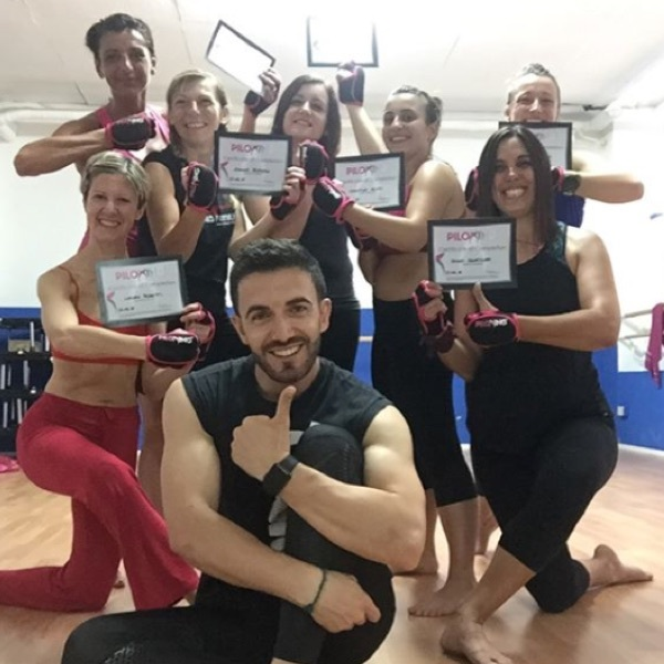Photo of newly certified Piloxing Instructors holding their Piloxing certifications